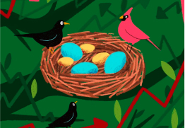 A black bird and a red bird sit on the edge of a nest filled with two different kinds of eggs.
