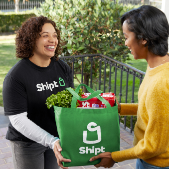 Shipt employee delivering items to a customer
