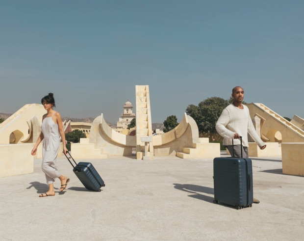 Travelers walking with rolling suitcases