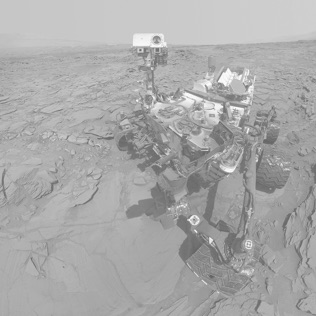 Black and white photo of NASA Curiosity rover on Mars