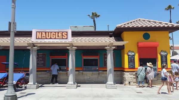 A modern building with bright walls labeled Naugles