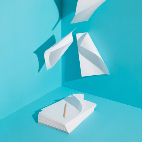 Sheets of white paper flying away