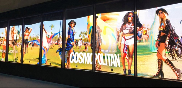 A massive video wall depicting Cosmopolitan fashions.