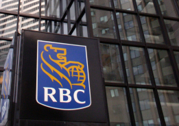 Photograph of an urban building with a close-up of the RBC sign featuring their logo.