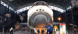Jean poses in front of the spaceship Discovery.