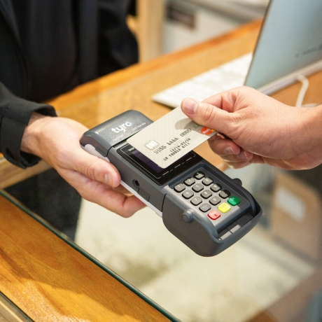 Person paying with credit card machine