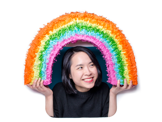 Happy new hire holding a rainbow piñata