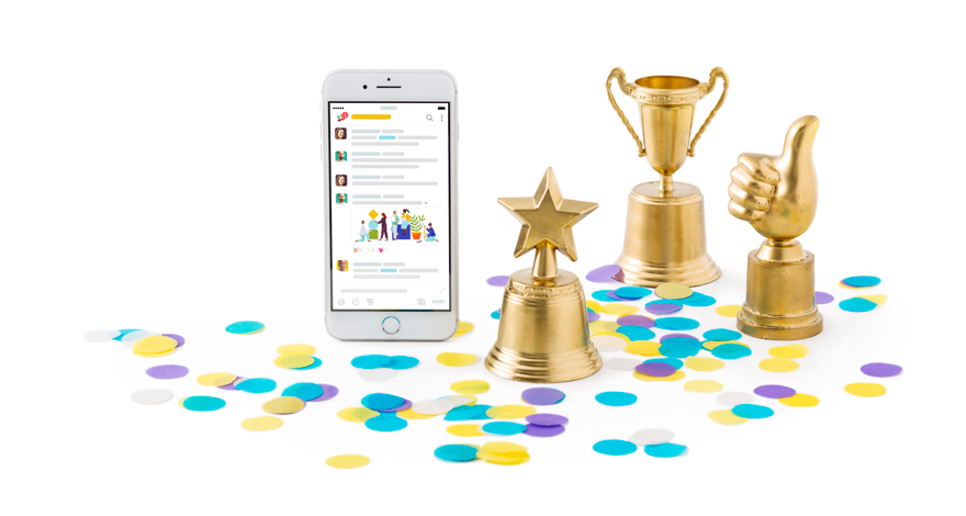Slack mobile app displayed on a smartphone alongside confetti and miniature trophies