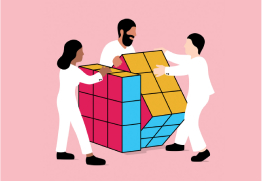 Three people solving a giant puzzle cube