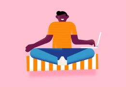 Person meditating with a laptop in hand