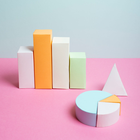 Three-dimensional bar and pie charts made of sugar paper