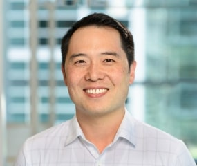 Headshot photo of Allen Shim