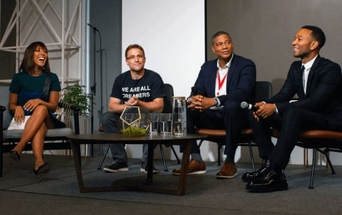 Robin Thede, Stewart Butterfield, Kenyatta Leal, and John Legend sit together on stage during a panel announcing the Next Chapter program.