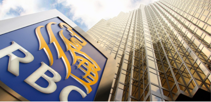 'An RBC sign in front of a skyscraper.'
