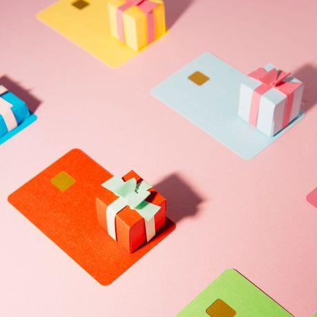 Multicoloured, stylised credit cards and some wrapped presents