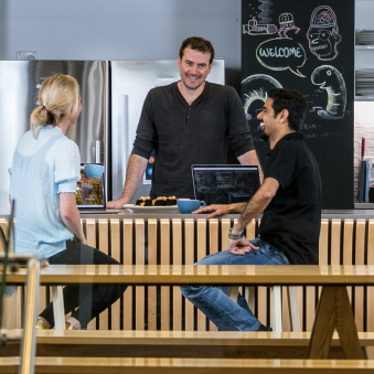 Xero employees having a conversation in a café