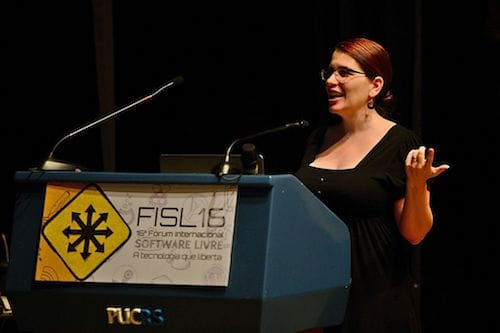 Karen speaks at a podium at International Free Software Forum.