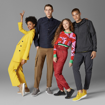 'A group of four people wearing Cole Haan's sneakers.'